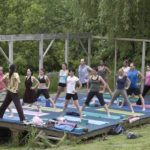 image of a yoga class on the stage